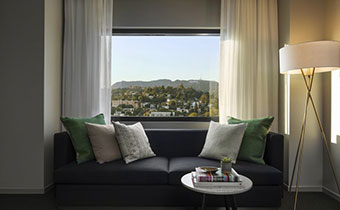 kimpton los angeles everly hotel hollywood city view guestroom sofa